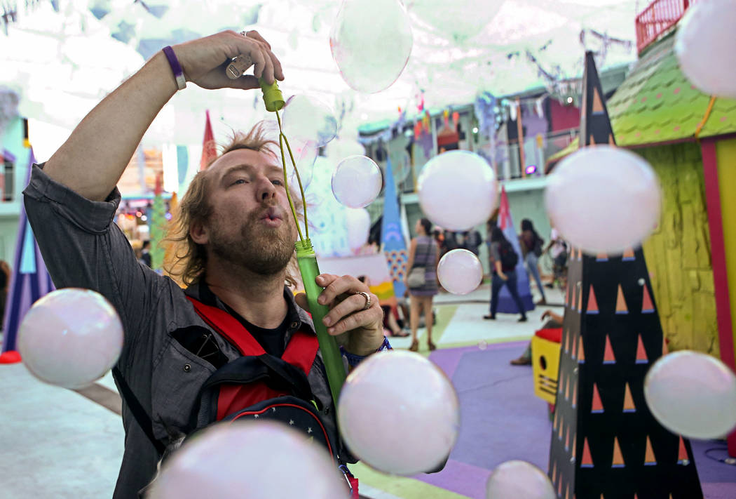 Graham Herbster blows vapor-filled bubbles at the Art Motel by Meow Wolf during the second day of the Life is Beautiful festival in downtown Las Vegas on Saturday, Sept. 23, 2017. Chase Stevens La ...