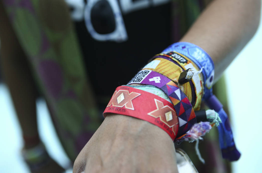 Sona Shah shows off her various festival wristbands during the second day of the Life is Beautiful festival in downtown Las Vegas on Saturday, Sept. 23, 2017. Chase Stevens Las Vegas Review-Journa ...