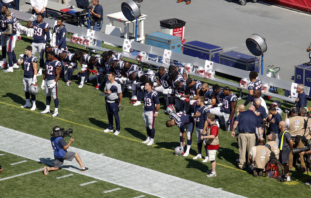 Several New England Patriots players kneel during the national anthem before an NFL football game against the Houston Texans, Sunday, Sept. 24, 2017, in Foxborough, Mass. (AP Photo/Stew Milne)