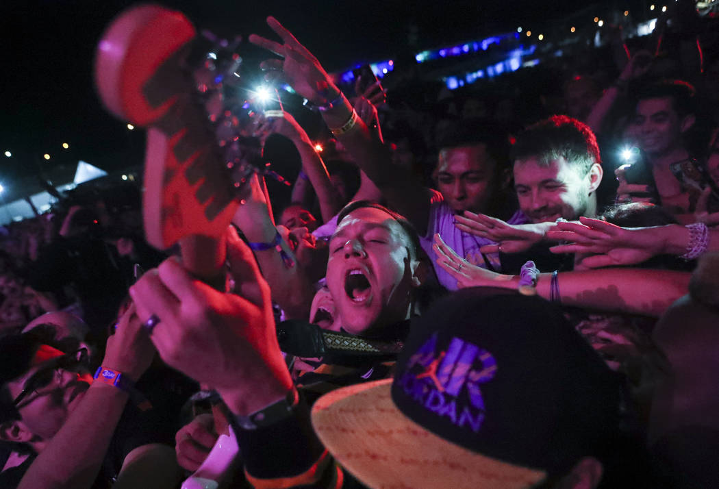 Brad Shultz of Cage the Elephant gets in the crowd while performing at the Downtown stage during the second day of the Life is Beautiful festival in downtown Las Vegas on Saturday, Sept. 23, 2017. ...