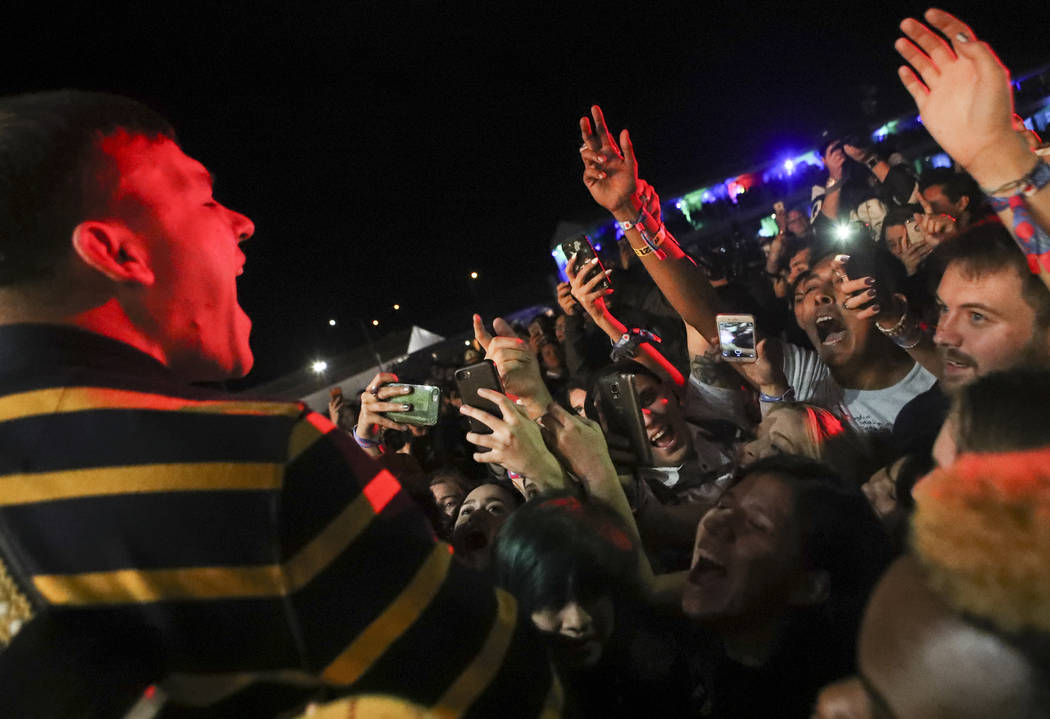 Brad Shultz of Cage the Elephant gets up close with the crowd while performing at the Downtown stage during the second day of the Life is Beautiful festival in downtown Las Vegas on Saturday, Sept ...