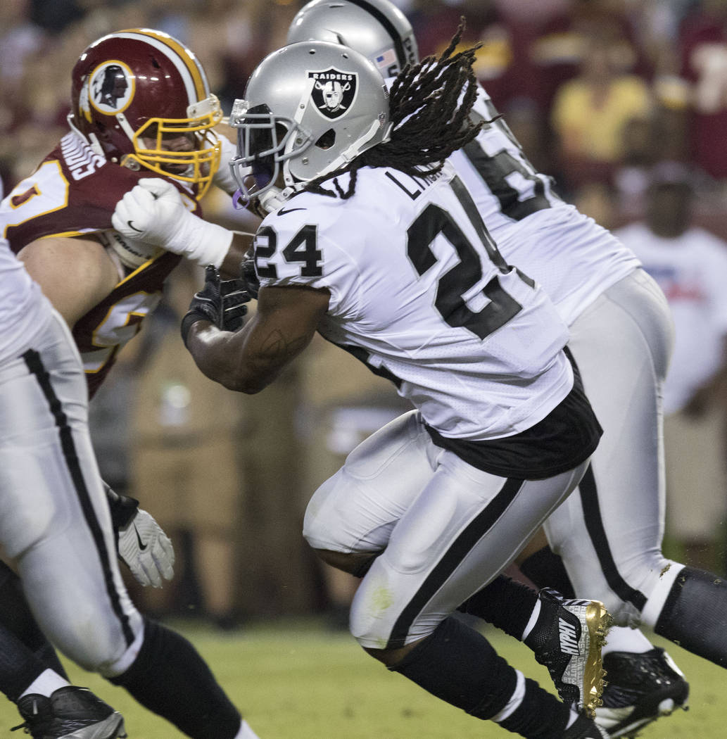 Oakland Raiders running back Marshawn Lynch (24) carries the football in the first half of the game against the Washington Redskins in Landover, Maryland, Sunday, Sept. 24, 2017. Heidi Fang Las Ve ...