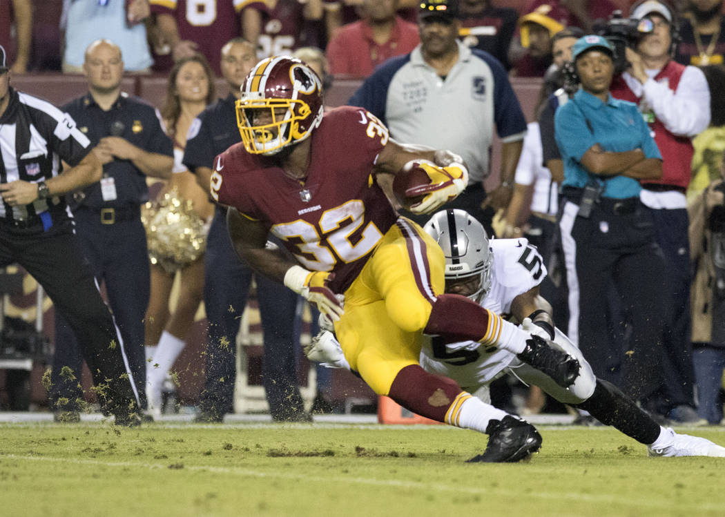 Washington Redskins running back Samaje Perine (32) carries the football in the first half of their game against the Oakland Raiders in Landover, Md., Sunday, Sept. 24, 2017. Heidi Fang Las Vegas  ...