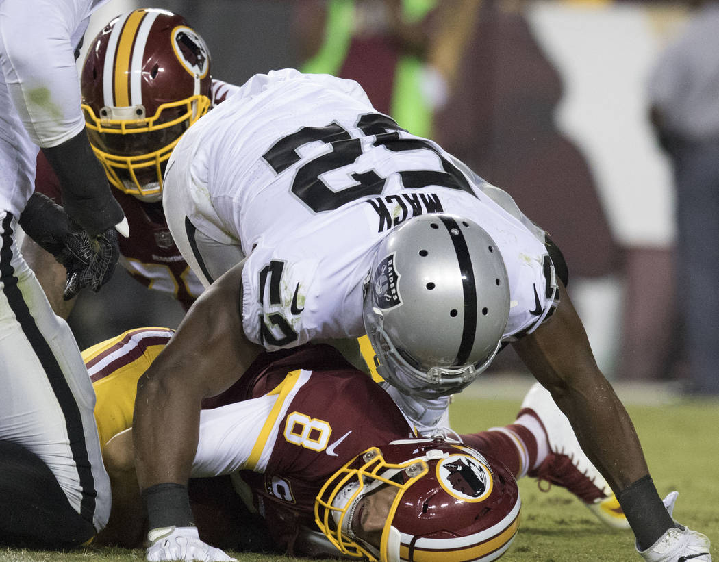 Oakland Raiders defensive end Khalil Mack (52) sacks Washington Redskins quarterback Kirk Cousins (8) in the first half of their game in Landover, Md., Sunday, Sept. 24, 2017. Heidi Fang Las Vegas ...