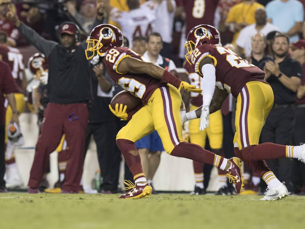 Washington Redskins cornerback Kendall Fuller (29) intercepts Oakland Raiders quarterback Derek Carr (4), not pictured, in the first half of their game in Landover, Md., Sunday, Sept. 24, 2017. He ...