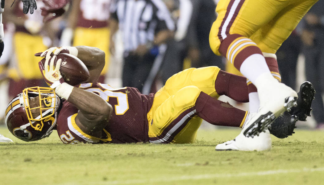 Washington Redskins running back Samaje Perine (32) after being tackled in the first half of their game against the Oakland Raiders in Landover, Md., Sunday, Sept. 24, 2017. Heidi Fang Las Vegas R ...