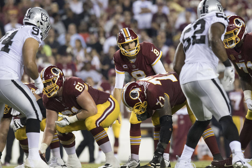 Washington Redskins quarterback Kirk Cousins (8) calls a play in the first half of their game against the Oakland Raiders in Landover, Md., Sunday, Sept. 24, 2017. Heidi Fang Las Vegas Review-Jour ...