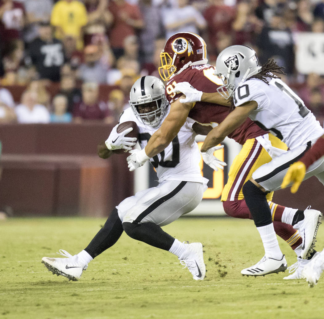 Oakland Raiders running back Jalen Richard (30) carries the football in the first half of their game against the Washington Redskins in Landover, Md., Sunday, Sept. 24, 2017. Heidi Fang Las Vegas  ...
