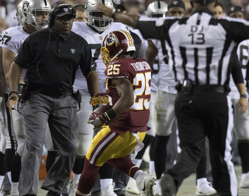 Washington Redskins running back Chris Thompson (25) runs out of bounds by the Oakland Raiders sideline in the first half of their game in Landover, Md., Sunday, Sept. 24, 2017. Heidi Fang Las Veg ...
