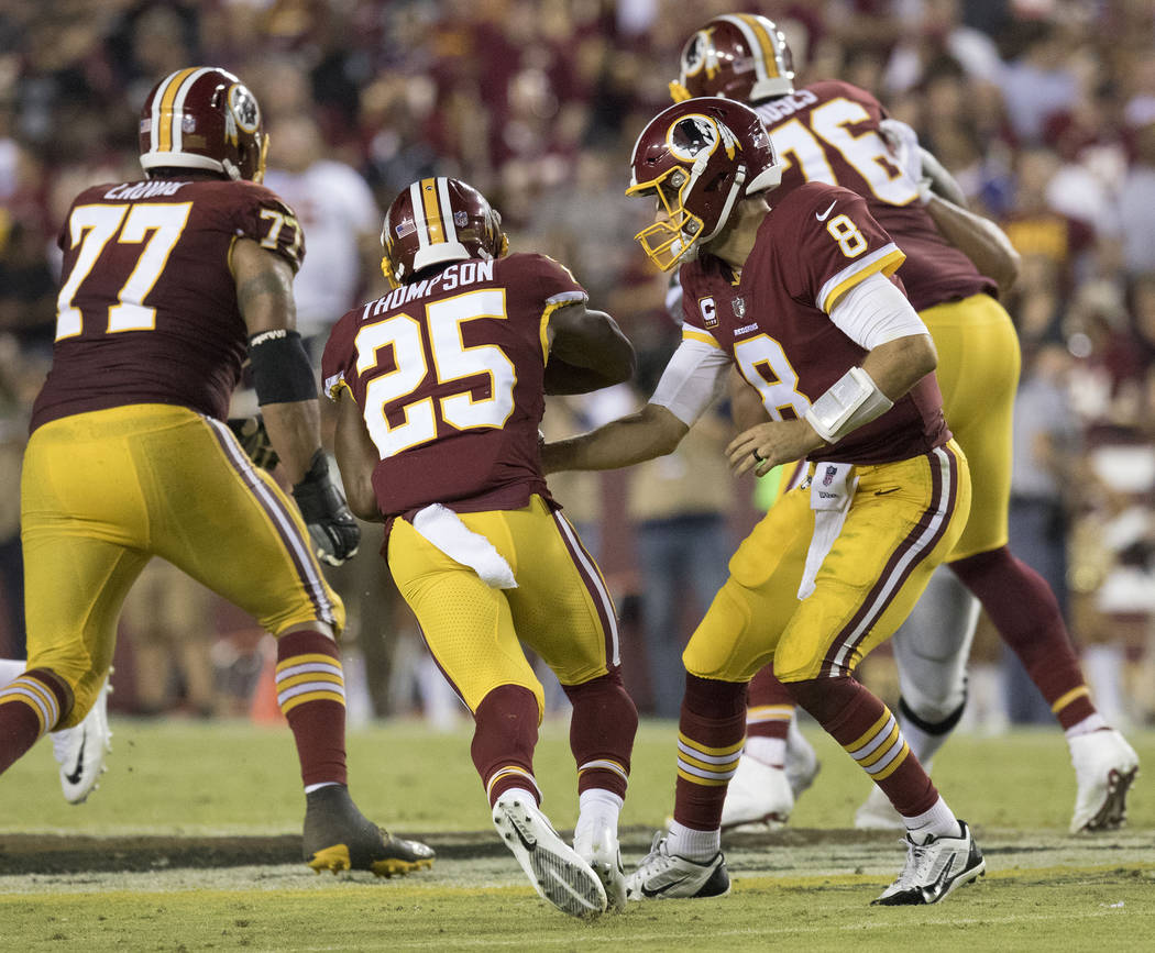 Washington Redskins running back Chris Thompson (25) carries the football in the first half of their game against the Oakland Raiders in Landover, Md., Sunday, Sept. 24, 2017. Heidi Fang Las Vegas ...
