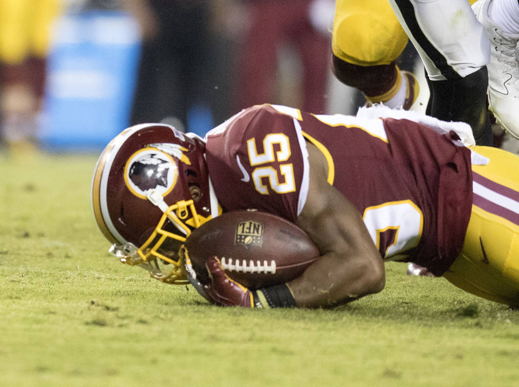Washington Redskins running back Chris Thompson (25) after being tackled in the second half of their game against the Oakland Raiders in Landover, Md., Sunday, Sept. 24, 2017. Heidi Fang Las Vegas ...