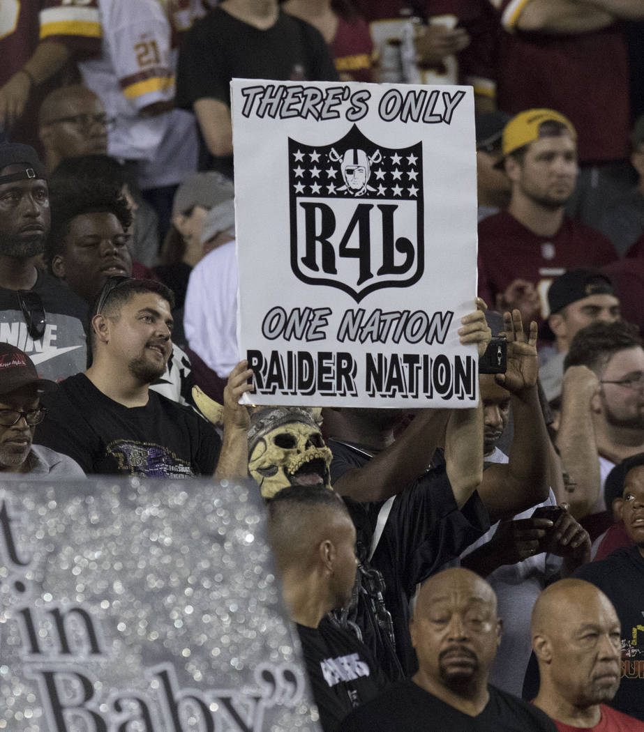 An Oakland Raiders fan holds up a sign in the first half of the team's game against the Washington Redskins at FedEx Field in Landover, Maryland, Sunday, Sept. 24, 2017. Heidi Fang Las Vegas Revie ...
