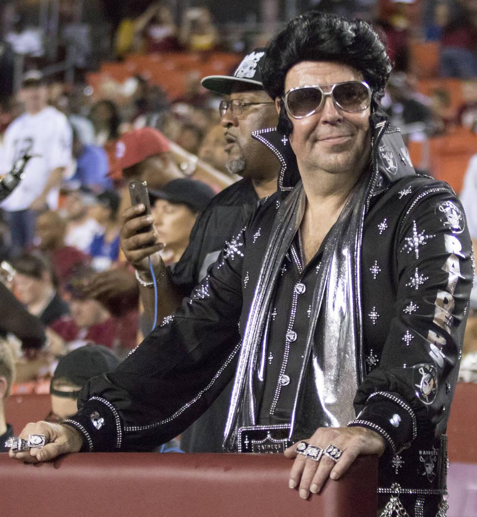 An Oakland Raiders fan dressed like Elvis Presley at FedEx Field in Landover, Maryland, Sunday, Sept. 24, 2017. Heidi Fang Las Vegas Review-Journal @HeidiFang