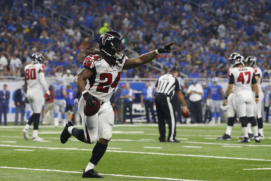 Atlanta Falcons running back Devonta Freeman gestures after scoring a touchdown during the first half of an NFL football game against the Detroit Lions, Sunday, Sept. 24, 2017, in Detroit. (AP Pho ...