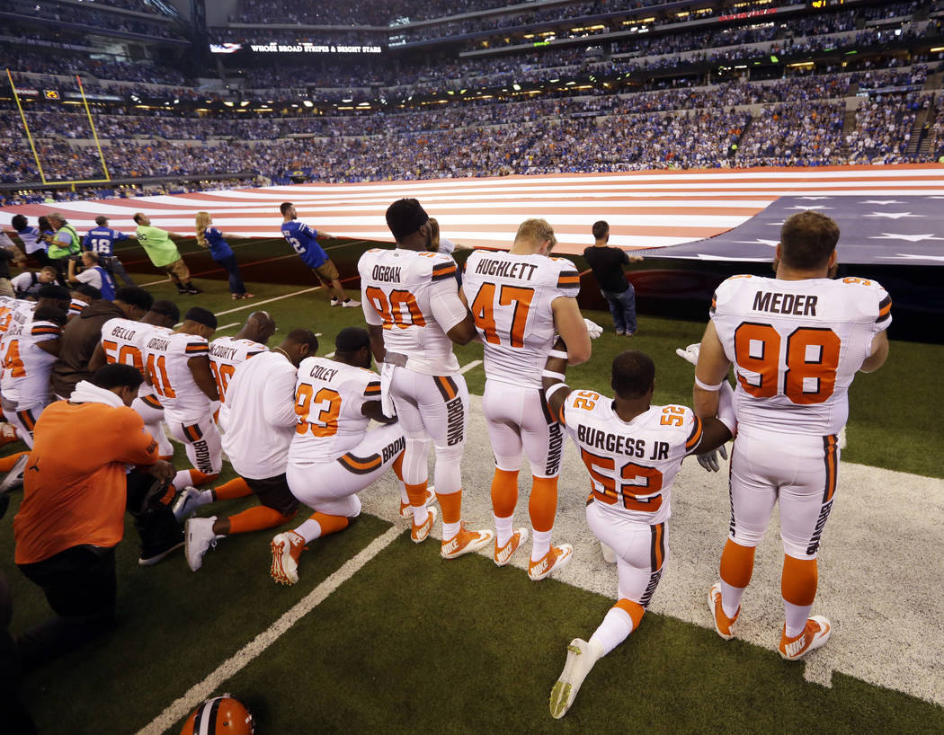 Members of the Cleveland Browns take a knee during the national anthem before an NFL football game against the Indianapolis Colts in Indianapolis, Sunday, Sept. 24, 2017. (AP Photo/Michael Conroy)