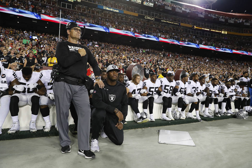 Some members of the Oakland Raiders kneel during the playing of the National Anthem before an NFL football game against the Washington Redskins in Landover, Md., Sunday, Sept. 24, 2017. (AP Photo/ ...