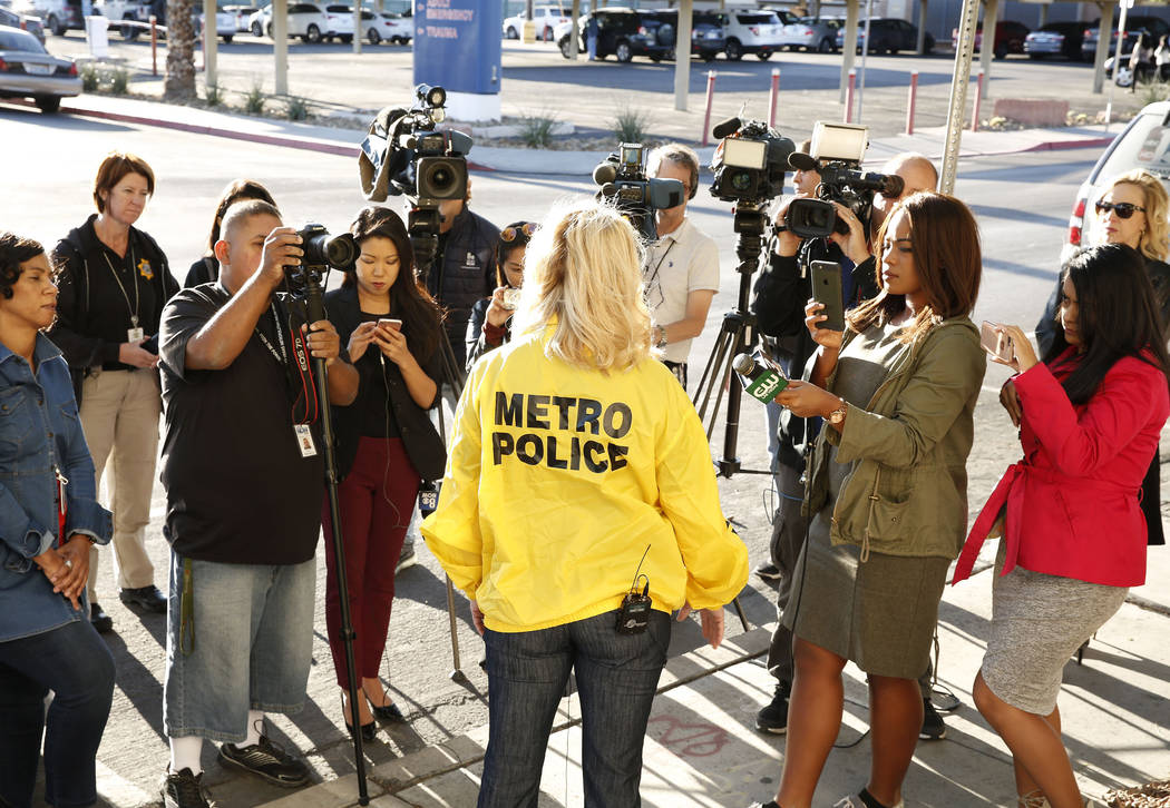 Metro Capt. Kelly McMahill, center, briefs the media on an officer-involved shooting at University Medical Center on Monday, Sept. 25, 2017, in Las Vegas. Bizuayehu Tesfaye Las Vegas Review-Journa ...