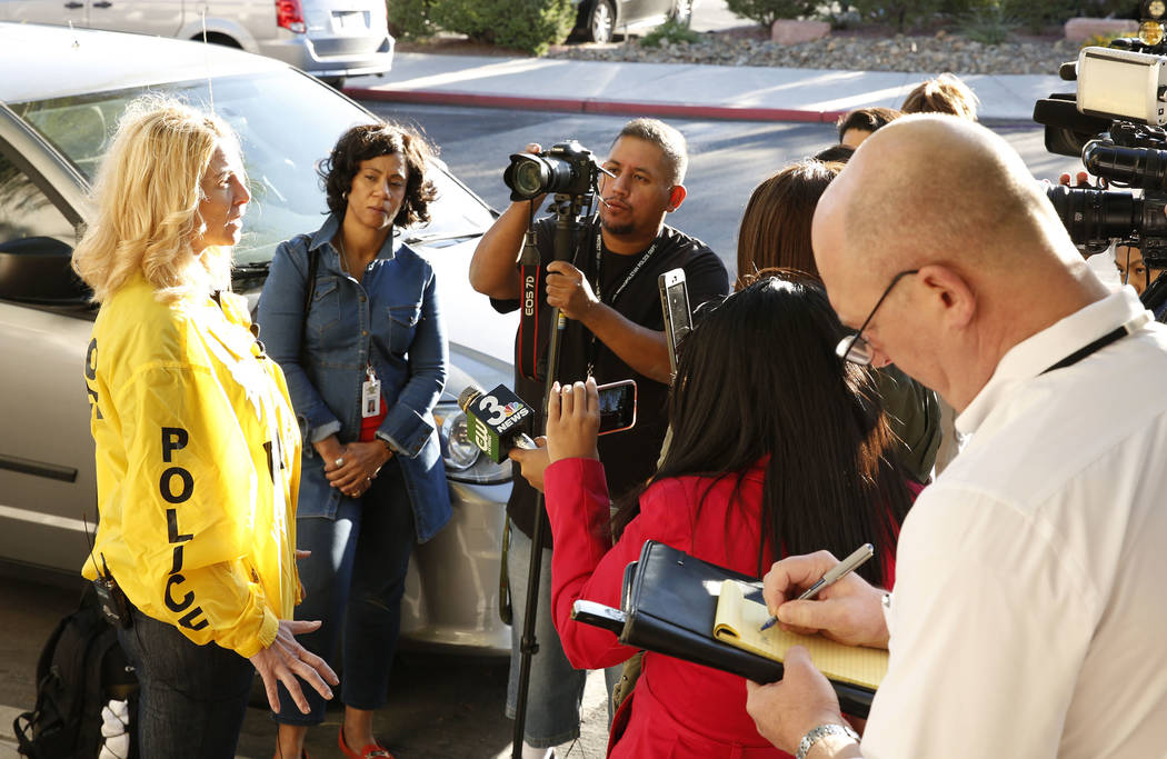 Metro Capt. Kelly Mcmahill, left, briefs the media on an officer-involved shooting at University Medical Center on Monday, Sept. 25, 2017, in Las Vegas. Bizuayehu Tesfaye Las Vegas Review-Journal  ...