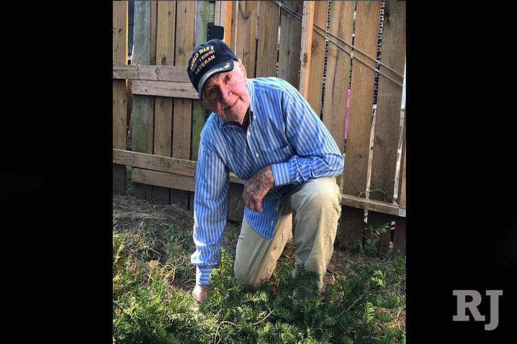 World War II veteran John Middlemas kneeling in support of NFL protests during the national athem. (BrennanmGilmore/Twitter)