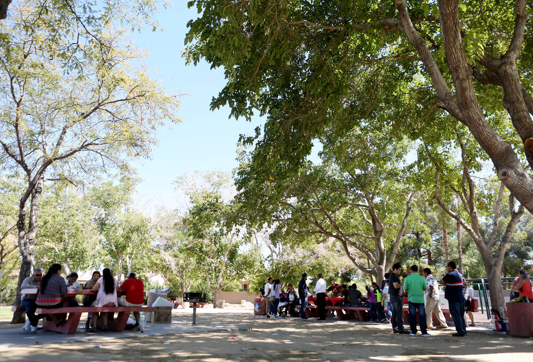 Members from Misin Cristiana Elim and other individuals from the community gather for lunch at Bob Basin Park in Las Vegas, Sunday, Sept. 24, 2017. (Elizabeth Brumley/Las Vegas Review-Journal)