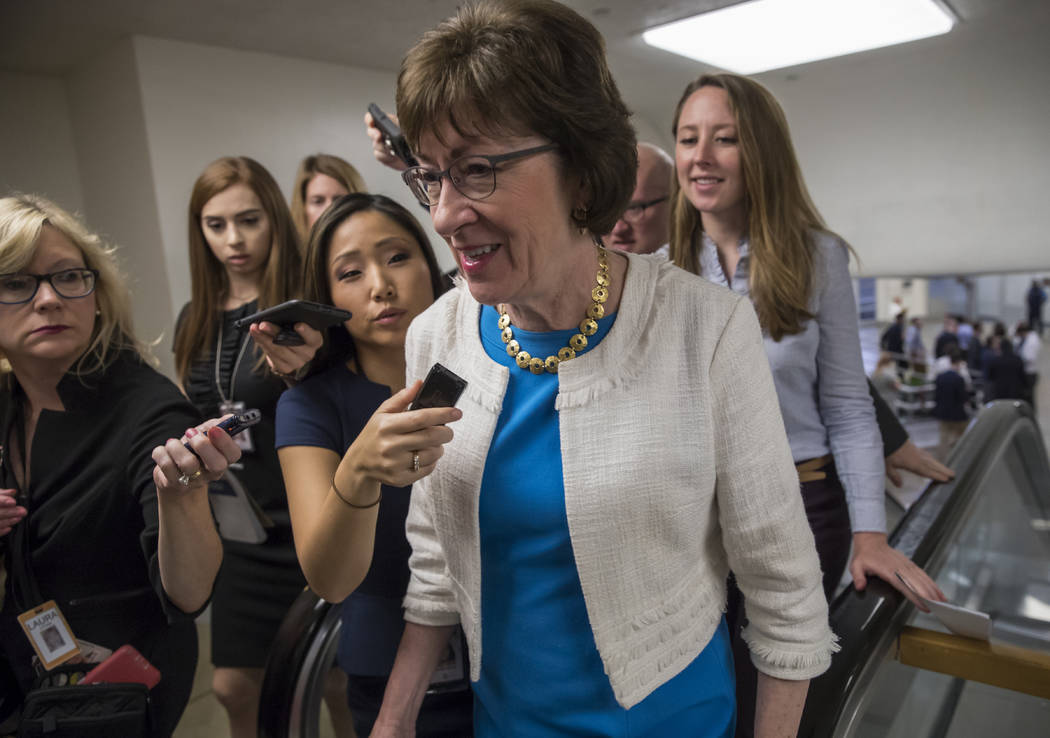 Sen. Susan Collins, R-Maine is surrounded by reporters as she heads to the Senate on Capitol Hill in Washington. (AP Photo/J. Scott Applewhite)