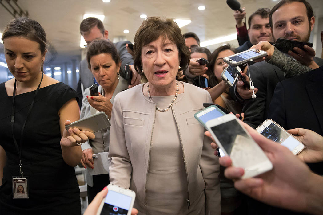 Sen. Susan Collins, R-Maine is surrounded by reporters as she arrives on Capitol Hill in Washington. (AP Photo/J. Scott Applewhite)
