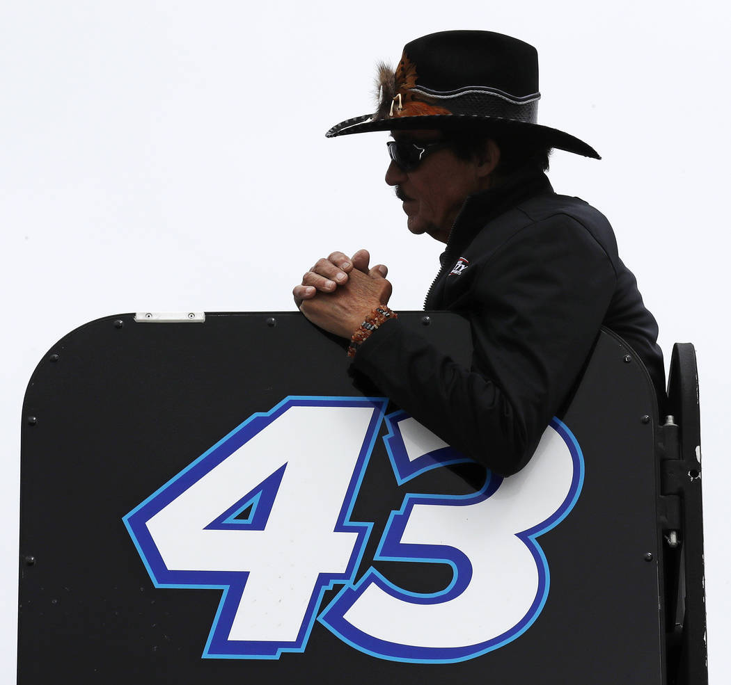 Racing legend Richard Petty watches practice prior to car qualifying for the NASCAR Cup Series auto race at New Hampshire Motor Speedway in Loudon, N.H., Friday, Sept. 22, 2017. (AP Photo/Charles  ...