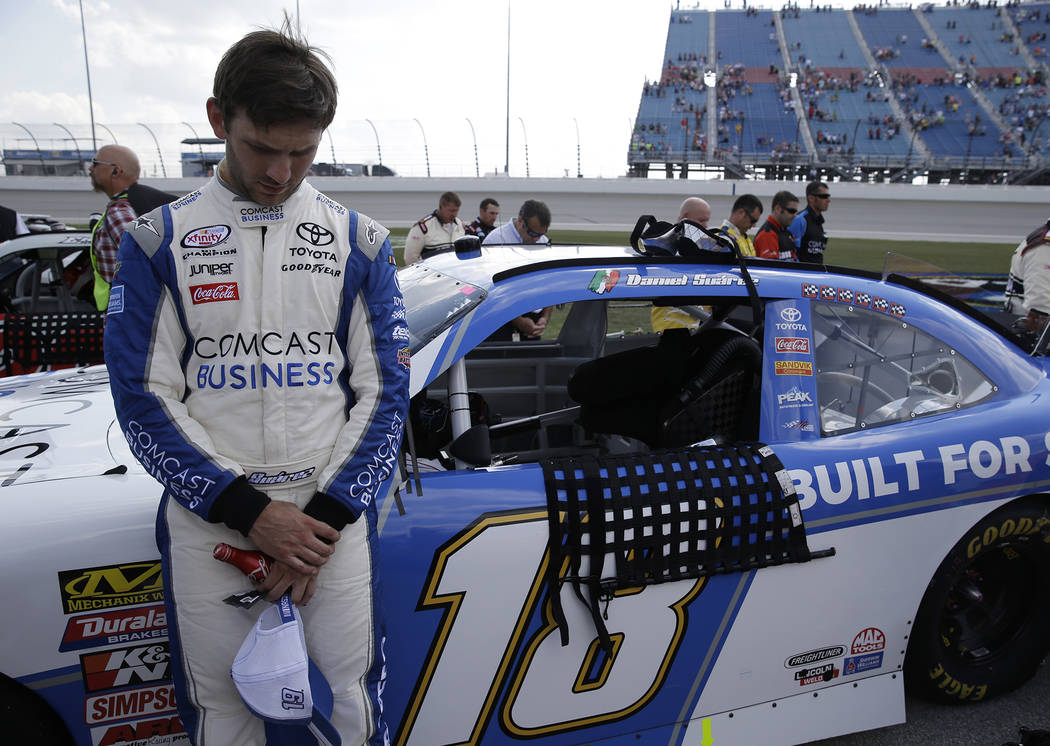 Daniel Suarez stands during the national anthem before the NASCAR Xfinity Series auto race at Chicagoland Speedway in Joliet, Ill., Saturday, Sept. 16, 2017. (AP Photo/Nam Y. Huh)