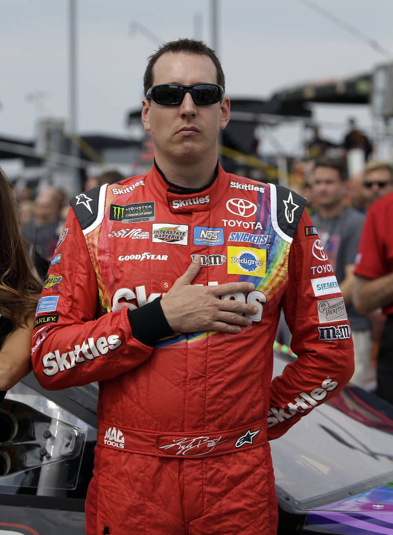 Kyle Busch stands during the national anthem before a NASCAR Cup Monster Energy Series auto race at Chicagoland Speedway in Joliet, Ill., Sunday, Sept. 17, 2017. (AP Photo/Nam Y. Huh)