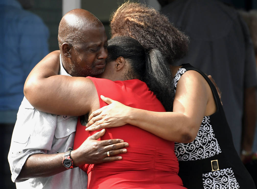 Leshea White and Kimberly Stallworth hug their uncle Roger Bracey, who was at Burnette Chapel Church of Christ when shots were fired, Sunday, Sept. 24, 2017, in Antioch, Tenn. They were reunited a ...