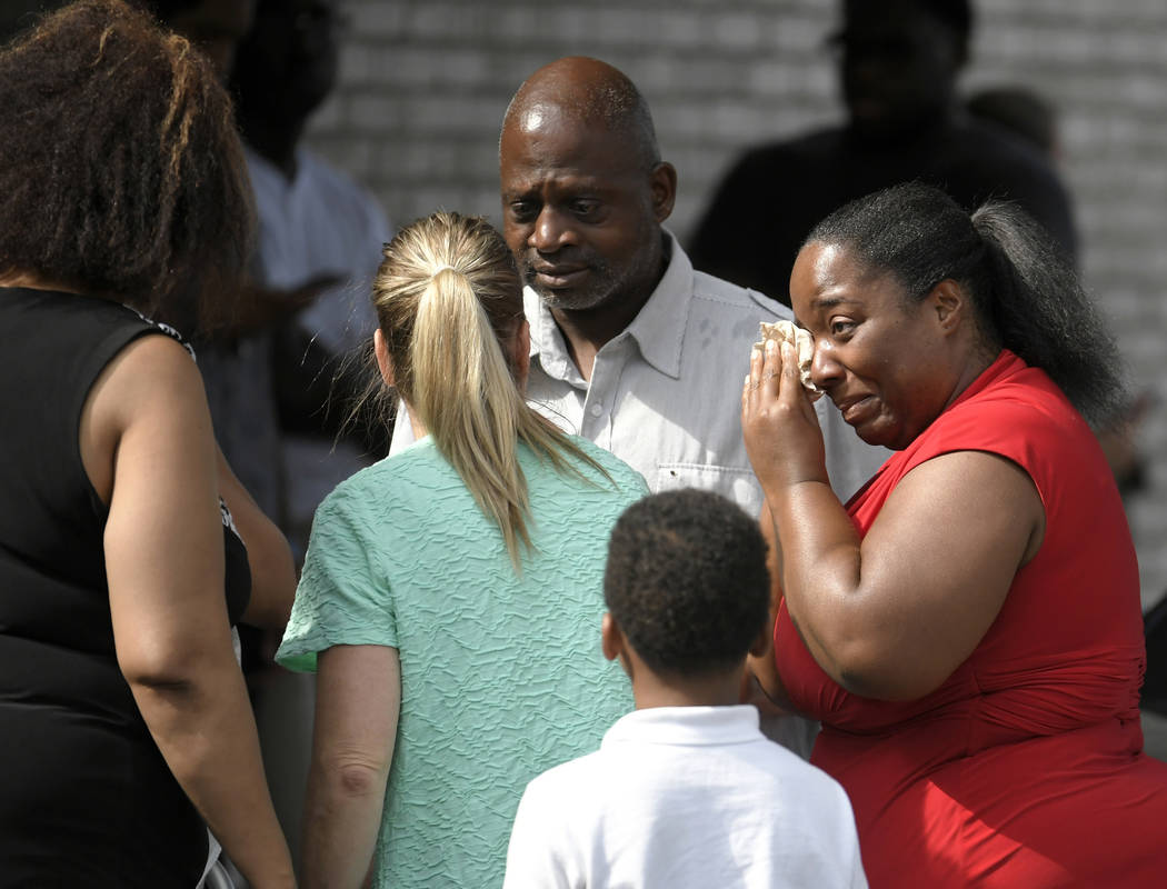 Ieshea White cries tears of joy after being reunited with her uncle Roger Bracey, center, who was at Burnette Chapel Church of Christ when shots were fired Sunday, Sept. 24, 2017, in Antioch, Tenn ...