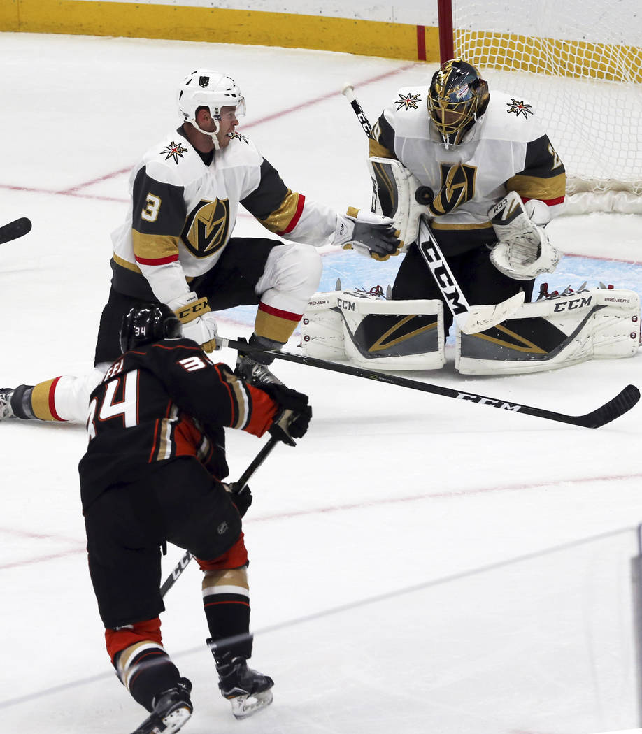 Vegas Golden Knights goalie Marc-Andre Fleury (29) defenseman Brayden McNabb (3) stop a shot on goal by Anaheim Ducks defenseman Cam Fowler (4) in the first period of an NHL preseason hockey game  ...