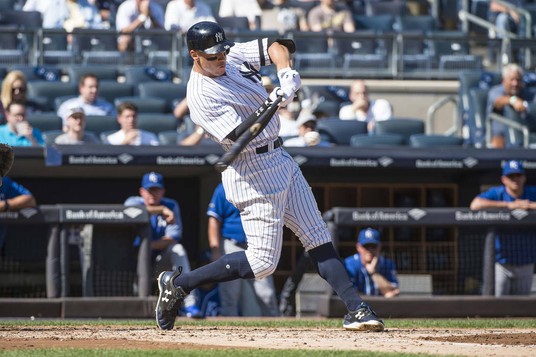 Sep 25, 2017; Bronx, NY, USA; New York Yankees right fielder Aaron Judge (99) hits his 49th home run against the Kansas City Royals during the third inning of the game at Yankee Stadium. (Gregory  ...