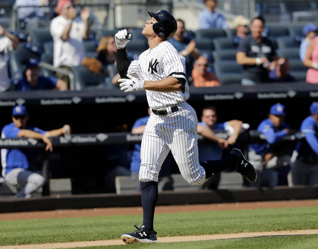 New York Yankees' Aaron Judge reacts as he runs the bases after hitting a two-run homer during the third inning of a baseball game against the Kansas City Royals at Yankee Stadium, Monday, Sept. 2 ...