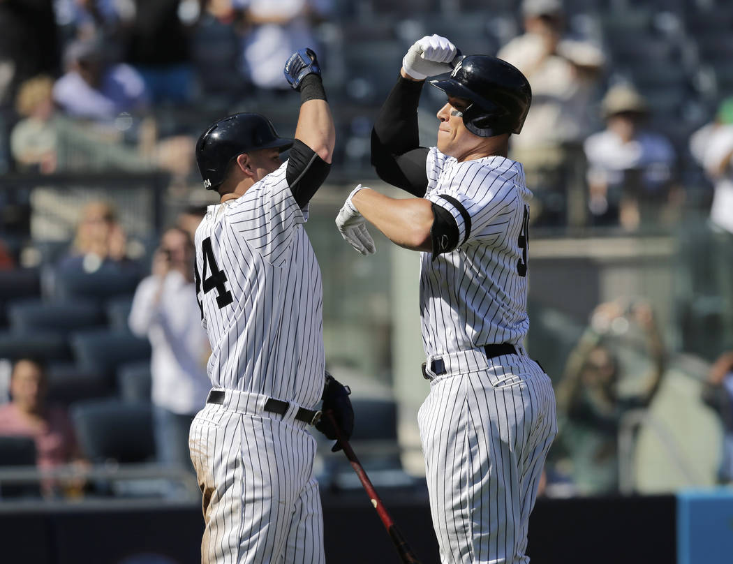 New York Yankees' Aaron Judge, right, celebrates his two-run homer with Gary Sanchez during the third inning of a baseball game against the Kansas City Royals at Yankee Stadium, Monday, Sept. 25,  ...