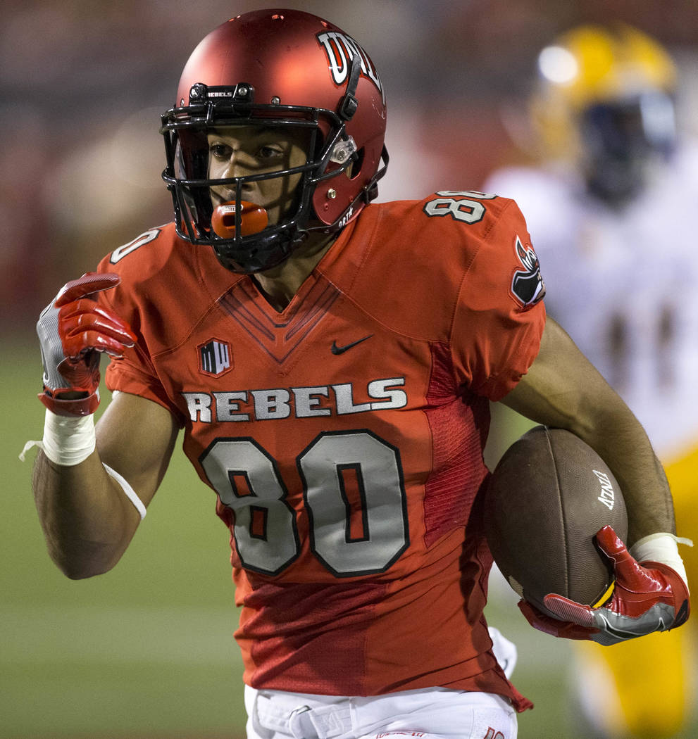 UNLV Rebels wide receiver Brandon Presley (80) heads towards the end zone for a touchdown after making a reception during the first half of an NCAA college football game between the UNLV Rebels an ...