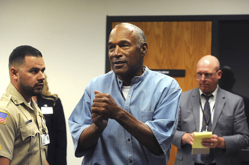 Former NFL football star O.J. Simpson reacts after learning he was granted parole at Lovelock Correctional Center in Lovelock, Nev., on Thursday, July 20, 2017. (Jason Bean/The Reno Gazette-Journa ...