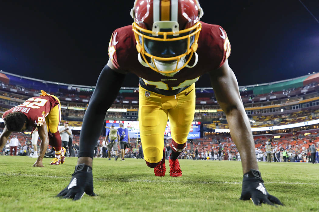 Washington Redskins cornerback Josh Norman (24) warms up before an NFL football game against the Oakland Raiders in Landover, Md., Sunday, Sept. 24, 2017. (AP Photo/Alex Brandon)