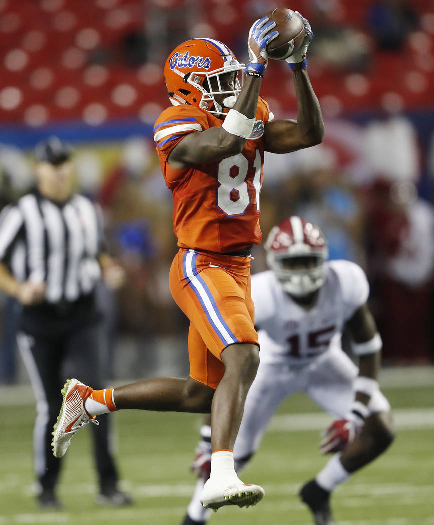 This Dec. 3, 2016, file photo shows Florida wide receiver Antonio Callaway (81) making the catch ahead of Alabama defensive back Ronnie Harrison (15) during the first half of the Southeastern Conf ...