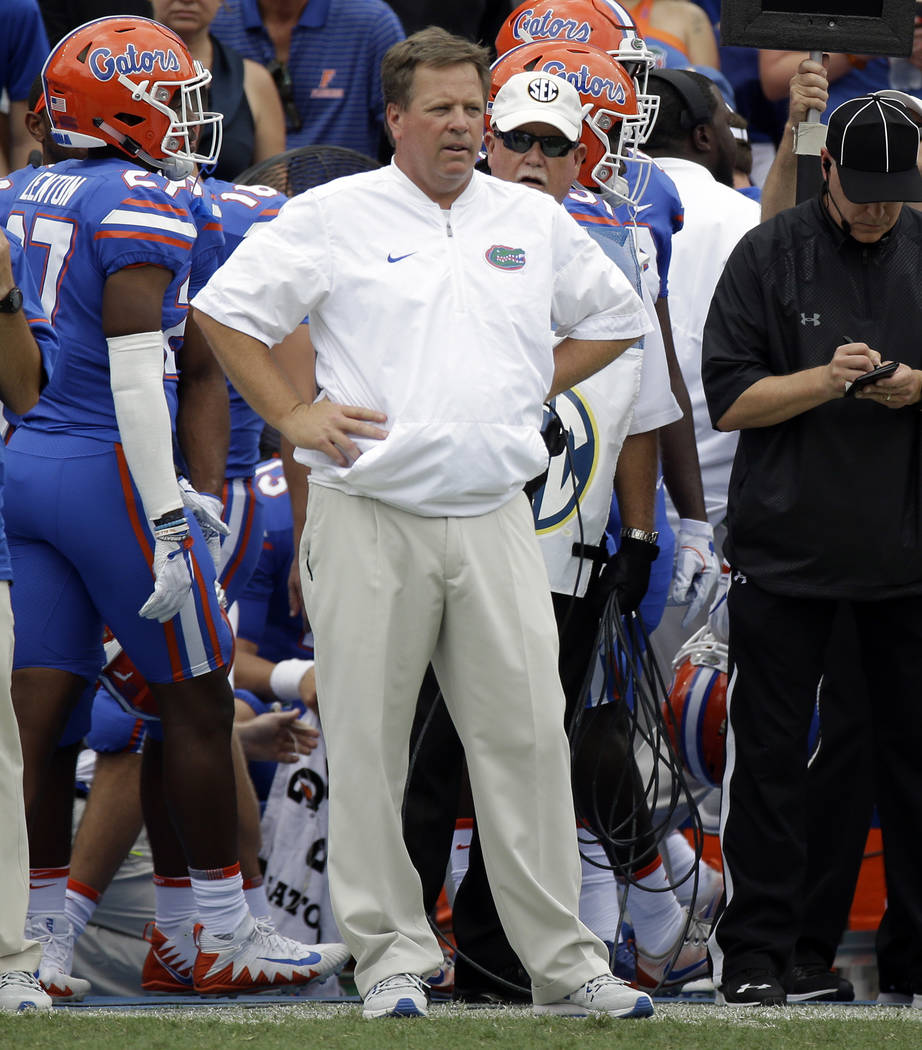 This Sept. 16, 2017, file photo shows Florida head coach Jim McElwain watches his team during the first half of an NCAA college football game against Tennessee, in Gainesville, Fla. Standout recei ...