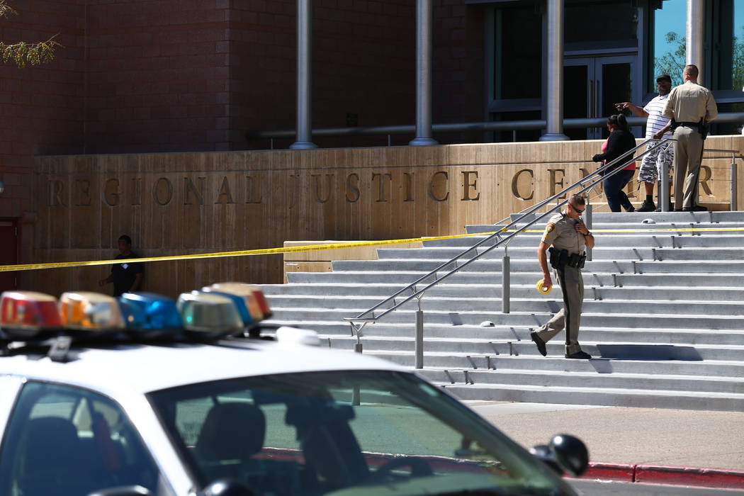Las Vegas investigate at the Regional Justice Center at Third Street and Lewis Avenue in downtown Las Vegas where a witness in a murder trial was struck and injured by a vehicle Monday, Sept. 25,  ...