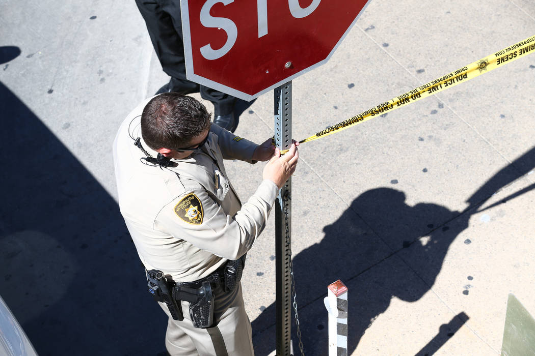 Las Vegas tape off the scene at the Regional Justice Center at Third Street and Lewis Avenue in downtown Las Vegas where a witness in a murder trial was struck and injured by a vehicle Monday, Sep ...