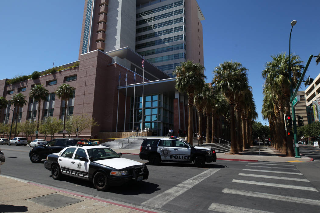 Las Vegas police investigate at the Regional Justice Center at Third Street and Lewis Avenue in downtown Las Vegas where a witness in a murder trial was struck and injured by a vehicle Monday, Sep ...
