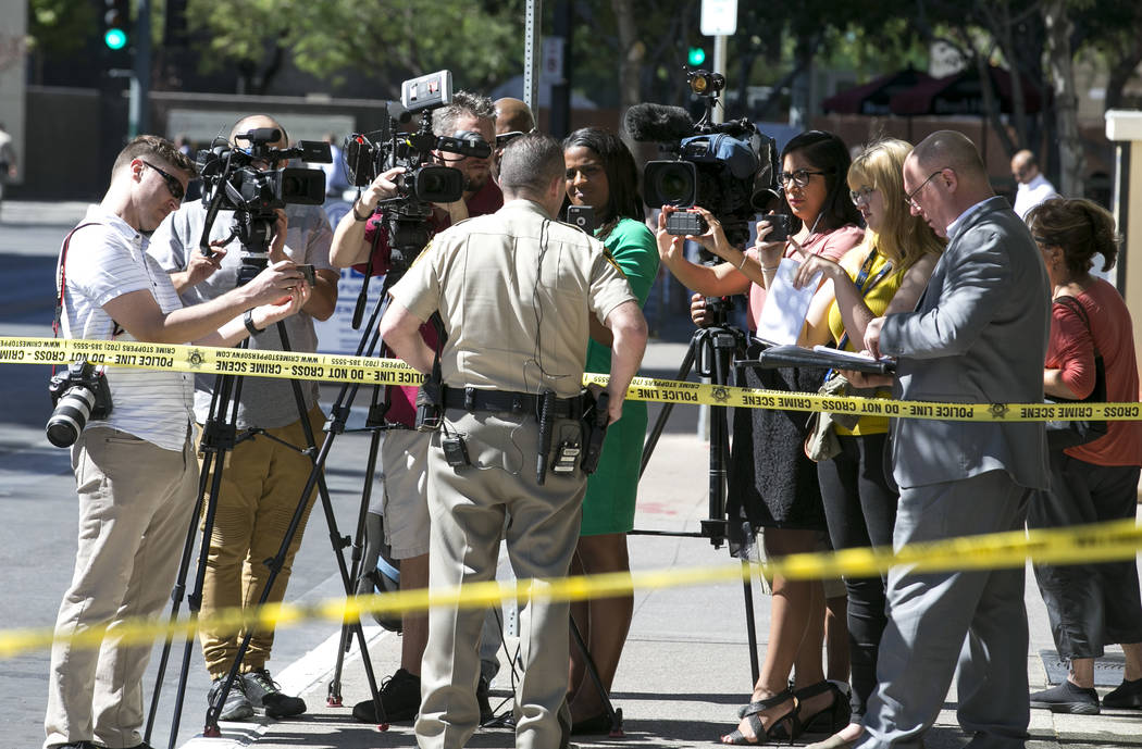 Las Vegas police brief the media outside the Regional Justice Center at Third Street and Lewis Avenue in downtown Las Vegas where a witness in a murder trial was struck and injured by a vehicle Mo ...