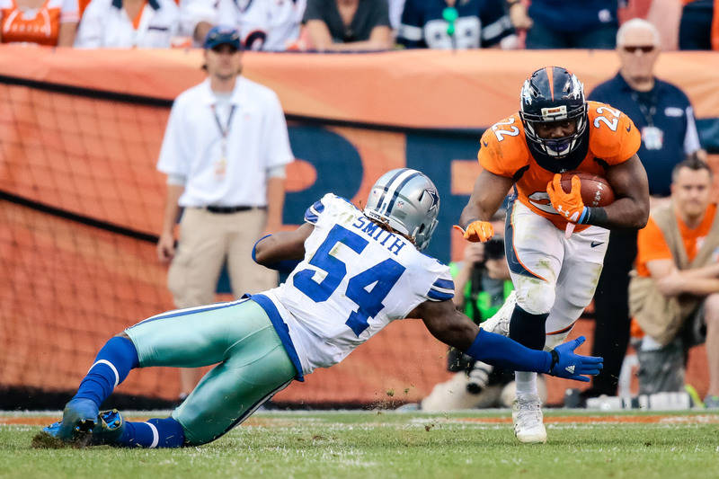 Sep 17, 2017; Denver, CO, USA; Dallas Cowboys outside linebacker Jaylon Smith (54) defends against Denver Broncos running back C.J. Anderson (22) in the fourth quarter at Sports Authority Field at ...