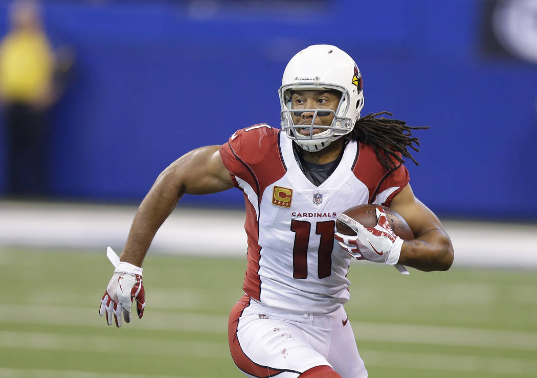 FILE - In this Sunday, Sept. 17, 2017, file photo, Arizona Cardinals' Larry Fitzgerald runs during the first half of an NFL football game against the Indianapolis Colts in Indianapolis. After a mo ...