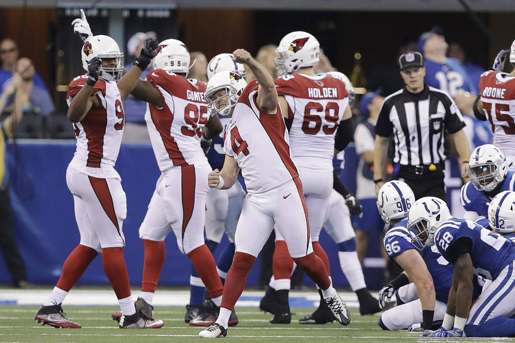 Arizona Cardinals' Phil Dawson (4) celebrates after kicking a game winning 30-yard field in overtime of an NFL football game against the Indianapolis Colts, Sunday, Sept. 17, 2017, in Indianapolis ...