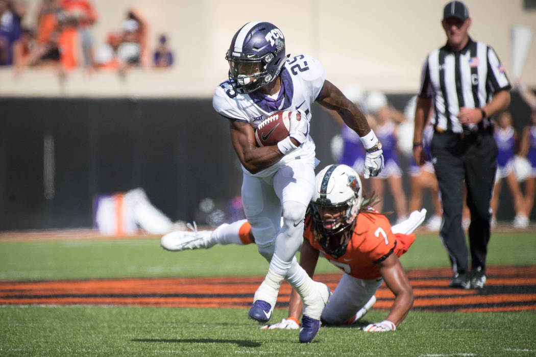 Sep 23, 2017; Stillwater, OK, USA; TCU Horned Frogs wide receiver KaVontae Turpin (25) runs the ball past Oklahoma State Cowboys safety Ramon Richards (7) during the first half at Boone Pickens St ...