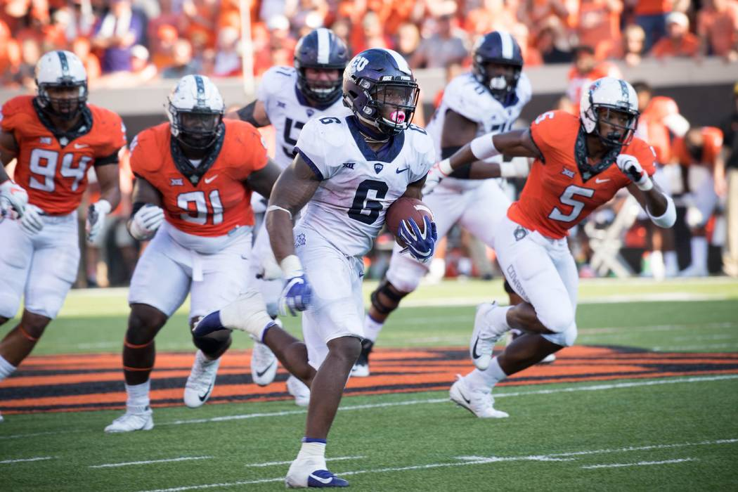 Sep 23, 2017; Stillwater, OK, USA; TCU Horned Frogs running back Darius Anderson (6) runs the ball for a touchdown during the second half at Boone Pickens Stadium. Mandatory Credit: Rob Ferguson-U ...