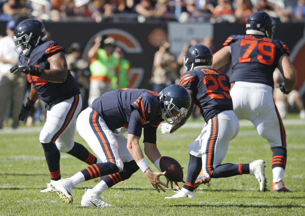 Chicago Bears quarterback Mike Glennon (8) recovers his own fumble during the second half of an NFL football game against the Pittsburgh Steelers, Sunday, Sept. 24, 2017, in Chicago. (AP Photo/Cha ...